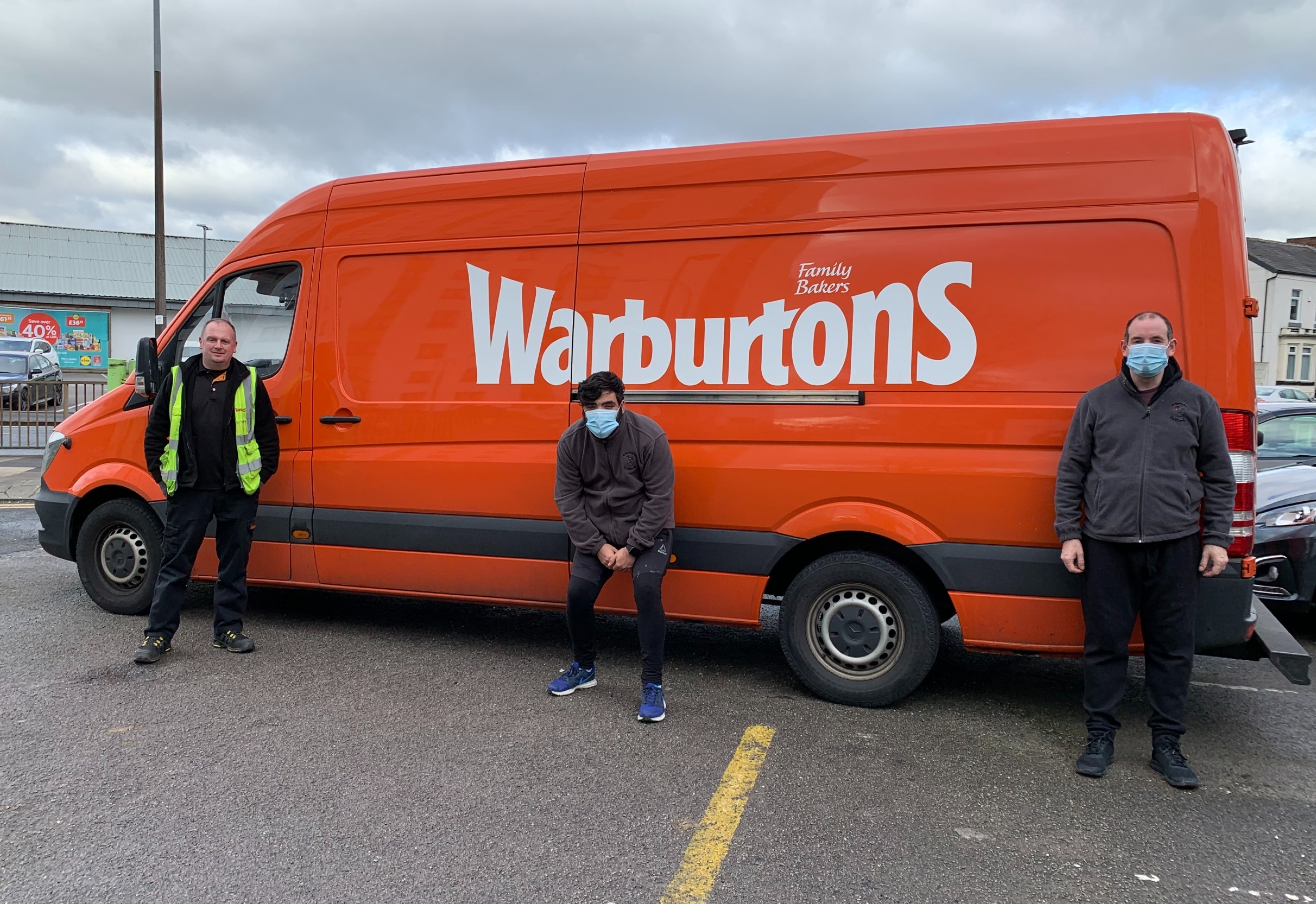 Garry from Warburtons with Damian and Kevin from Emmaus Salford