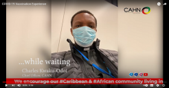 Still from YouTube video featuring Charles Kwaku-Odoi getting his vaccination