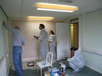IGT volunteers painting