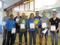 IGT volunteers with certificates